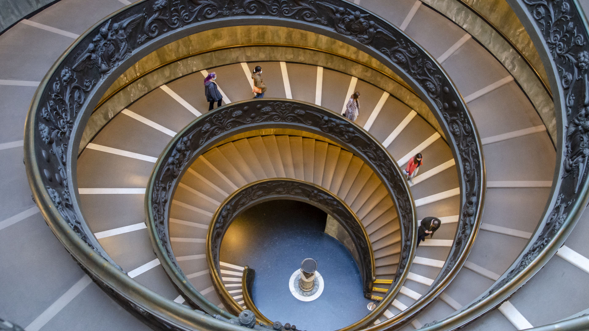 Students walking down the spiral steps at the Vatican Museums.