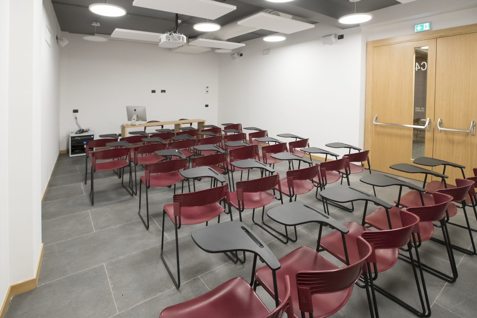 Classroom with rows of red chairs