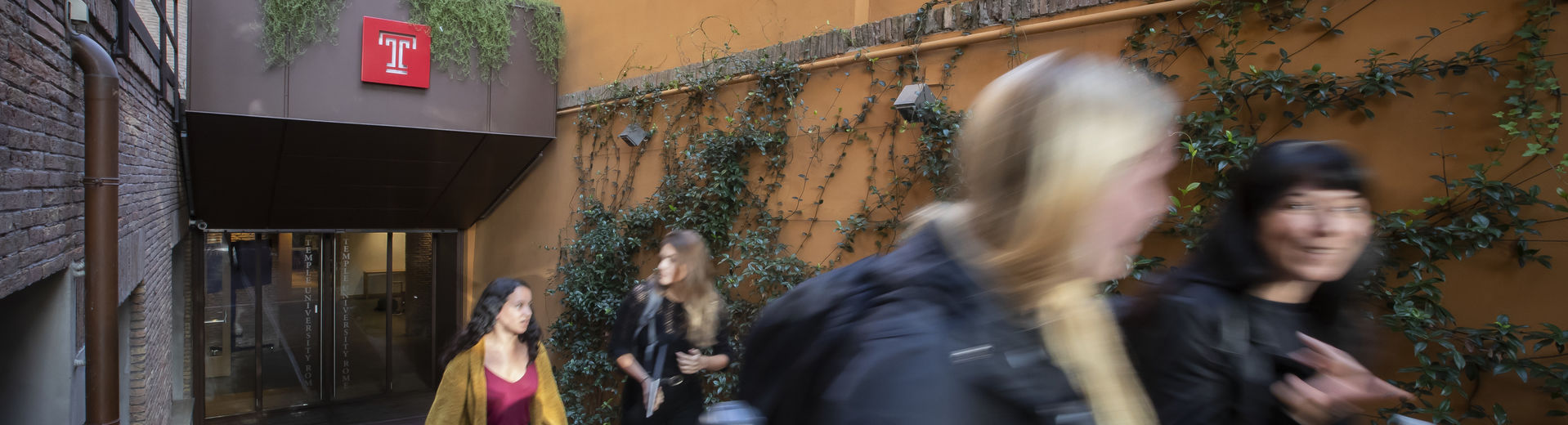 four students exiting Temple Rome