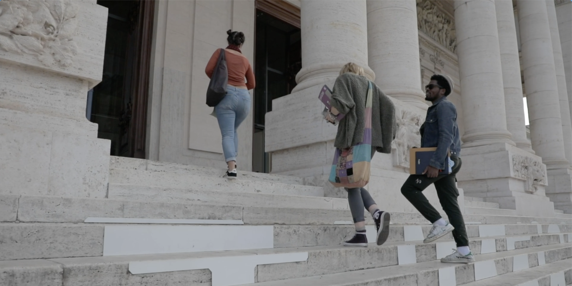 Three students walking into museum in Rome