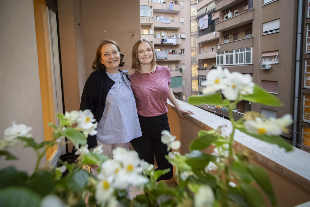 A student with her Italian host mom on their balcony in Rome