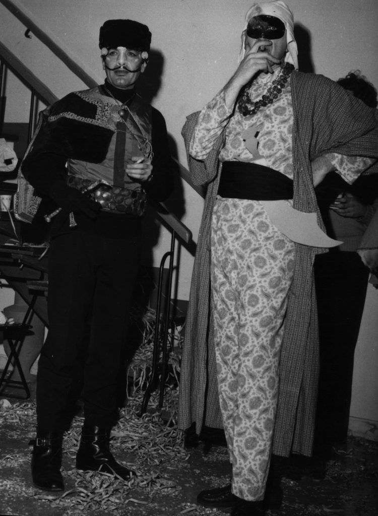 2 people in costume, in black and white